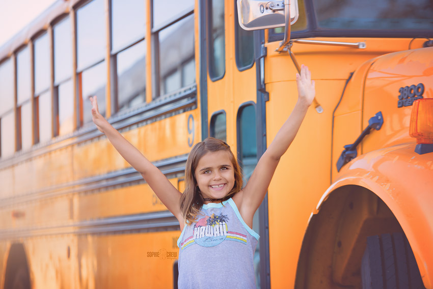 Child in front of school bus San Diego