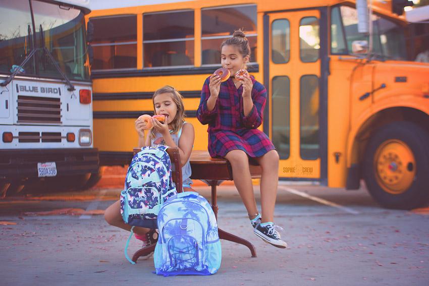 Kids in front of school bus