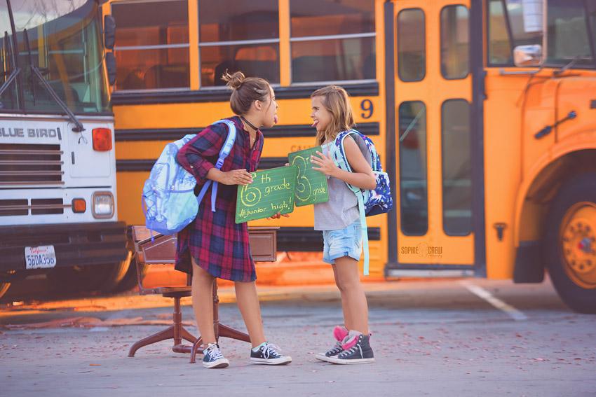 Kids in front of yellow school bus