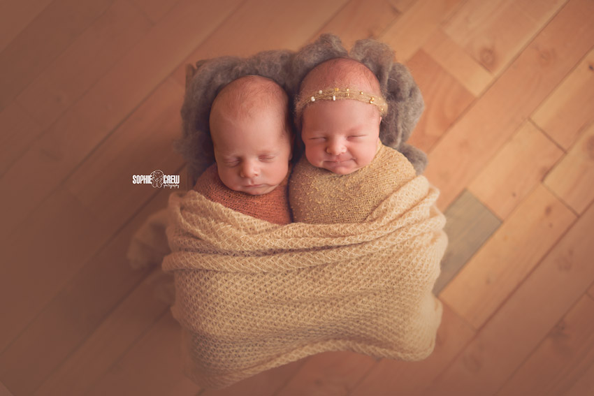 Newborn Twins in wooden crate in San Diego baby photography studio