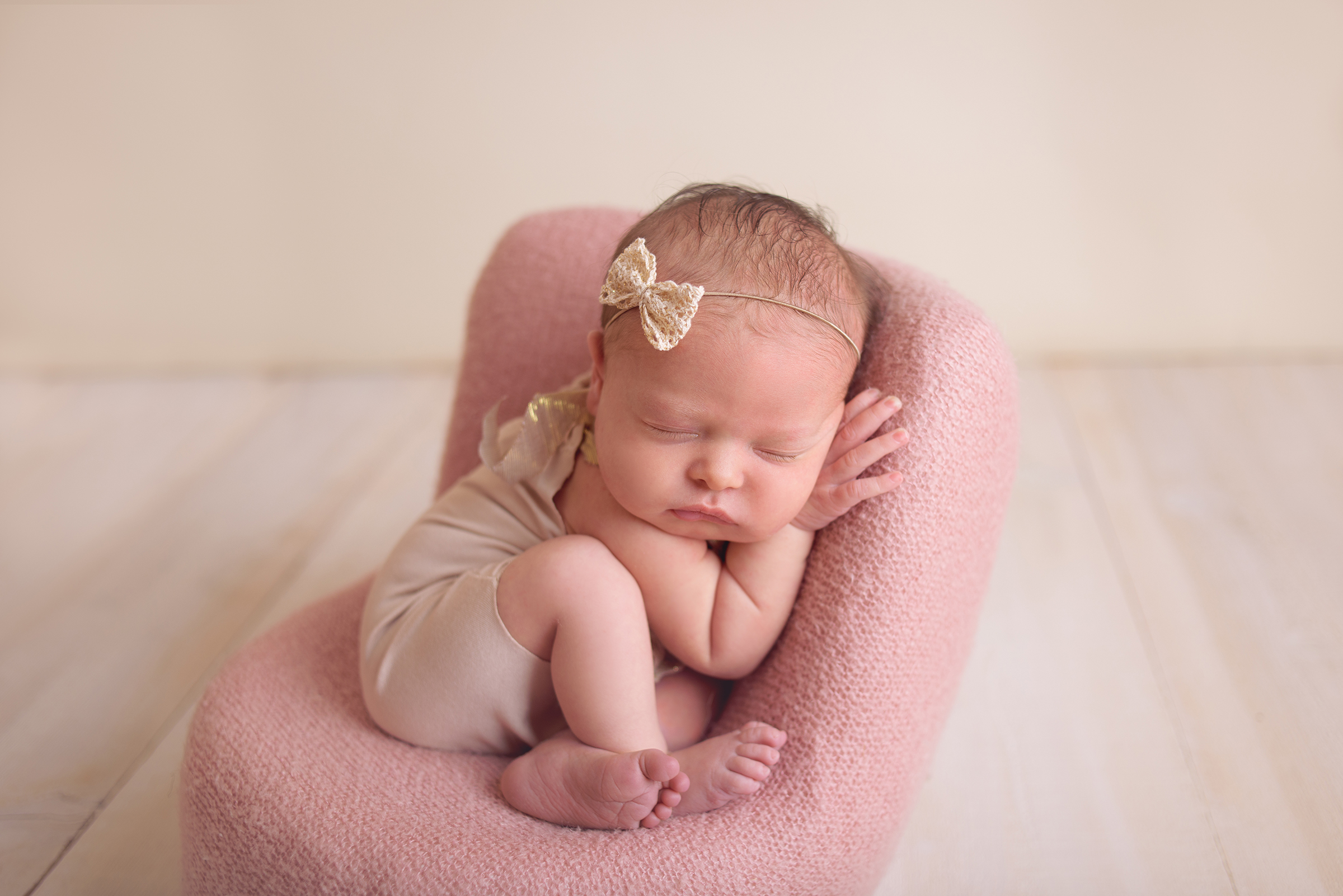 Newborn girl posed in DIY posing pod photography prop