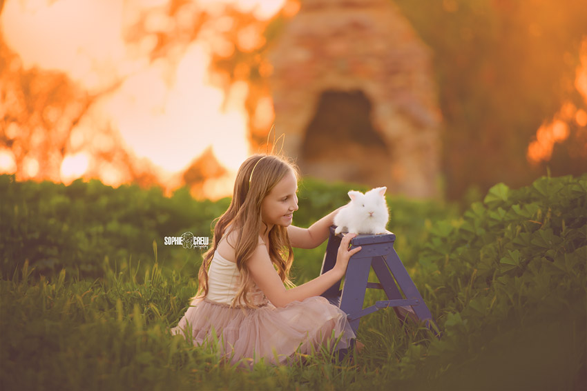 Young girl posing with white bunny rabbit for San Diego Photo Session