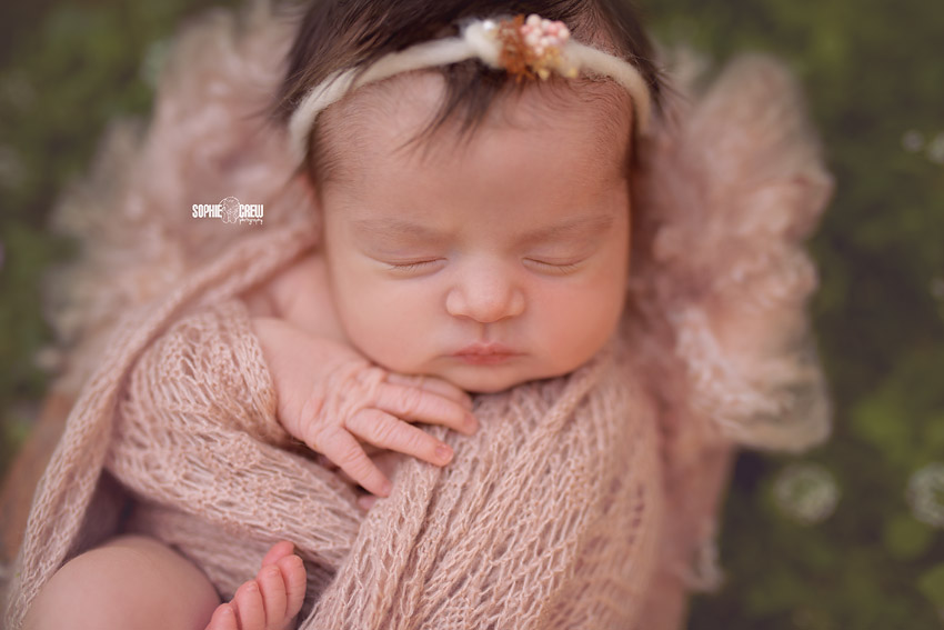 Newborn girl close up outdoors nature photography for baby