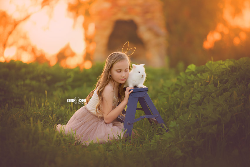 Kid and bunny posing in a nature setting for San Diego photography session