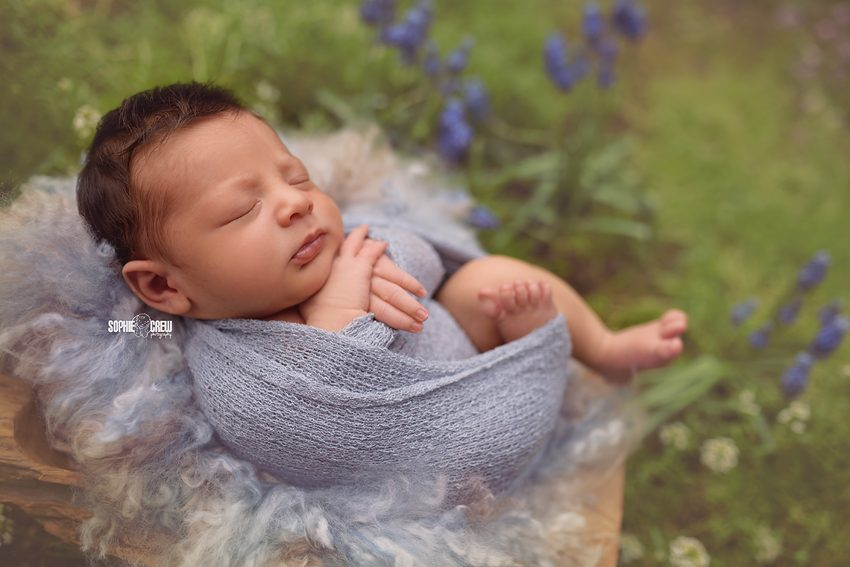 Newborn photography in garden nature setting in San Diego